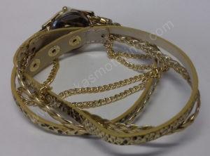 Moteriškas laikrodis aukso spalvos su medžiagine apyranke - iš galo