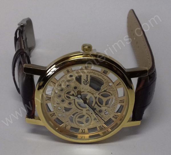 Vyriškas laikrodis su permatomu ciferblatu kaip Skeleton - ciferblatas iš arti ant šono