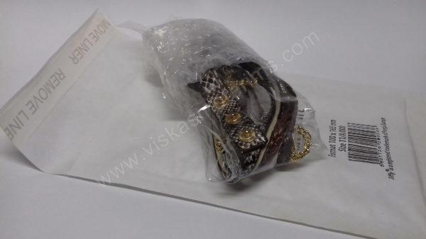 Moteriškas laikrodis ruda medžiagine apyranke - su voku