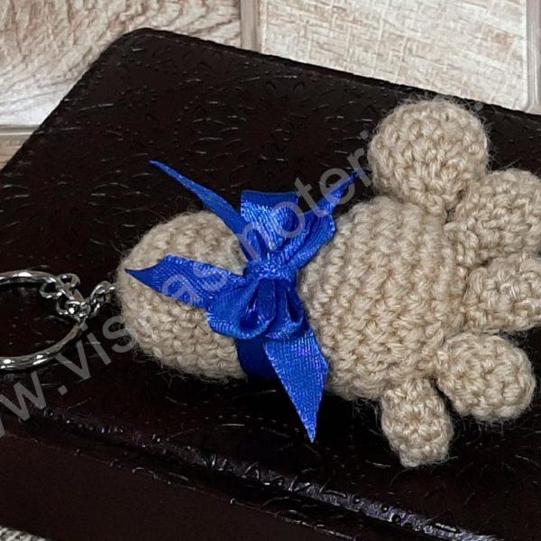 Nerta kreminės spavos pėdutė su mėlynu kaspinėliu - 01