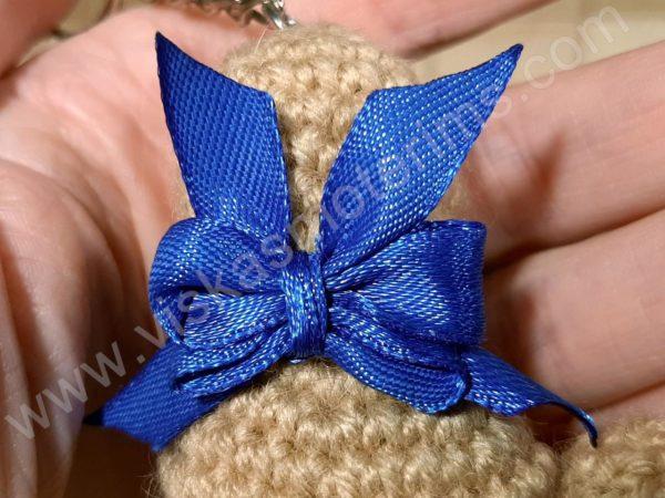 Nerta kreminės spavos pėdutė su mėlynu kaspinėliu - 06